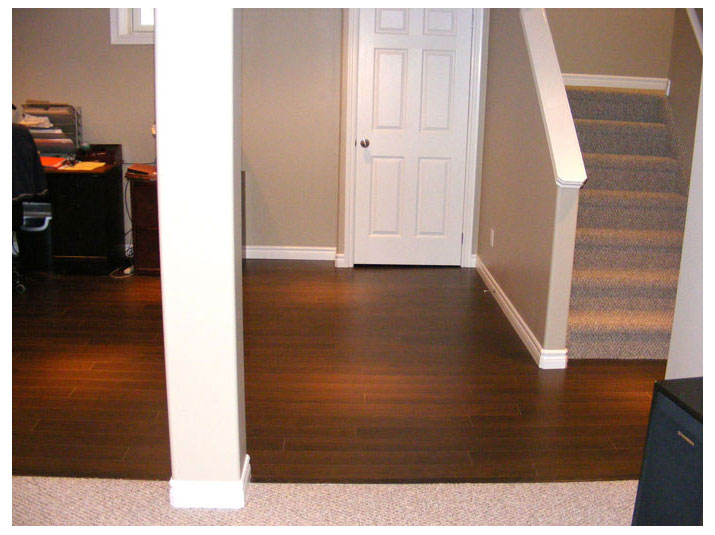 Laminate flooring installed in basement