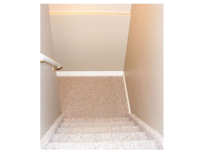 Berber carpet installed for basement stairs
