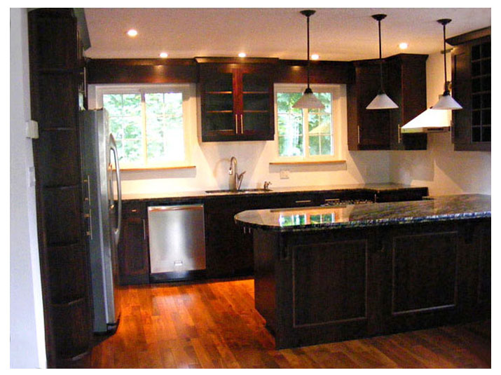 Oak kitchen units with granite countertops