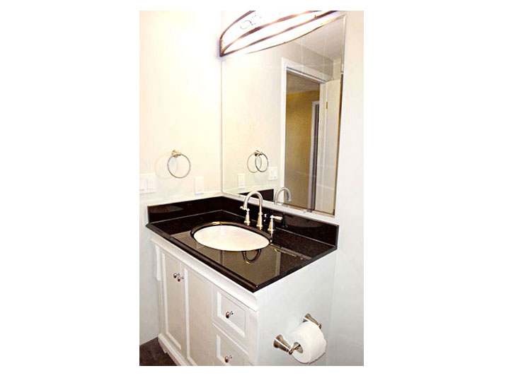 Bathroom vanity and granite countertop and backsplash