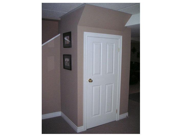 Storage closet under basement staircase
