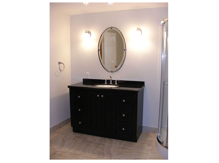 Black vanity with black granite countertop