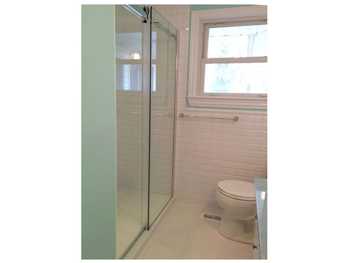 Shower with tiled walls & glass doors
