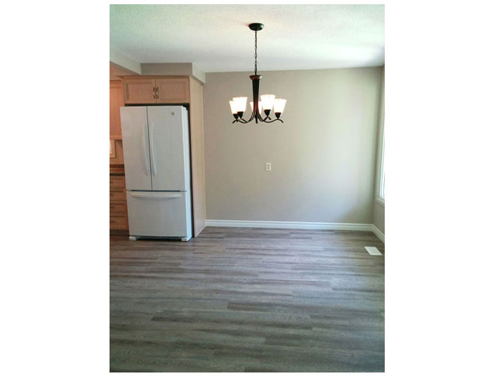 Affordable and stylish vinyl plank flooring in dining room