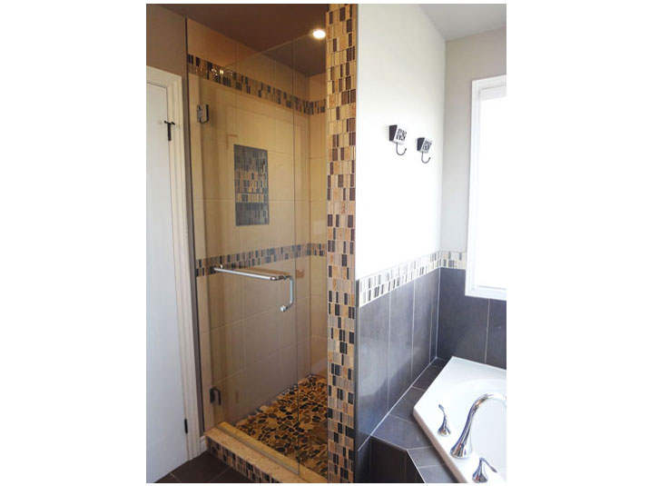 Tiled shower with glass door