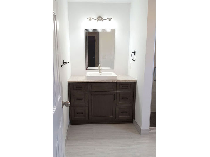 Brown vanity in the Master bathroom