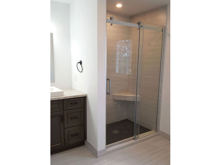 Walk-in shower with tile surround