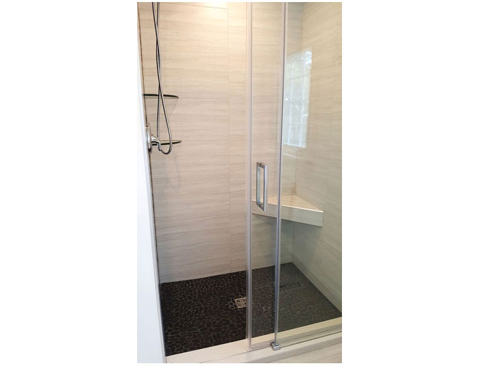 Flat pebble tile shower floor