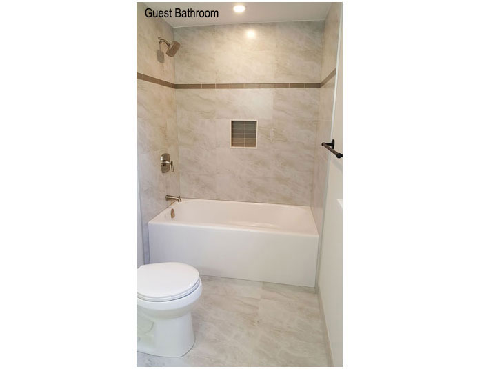 Subway porcelain tile shower surround with bathtub