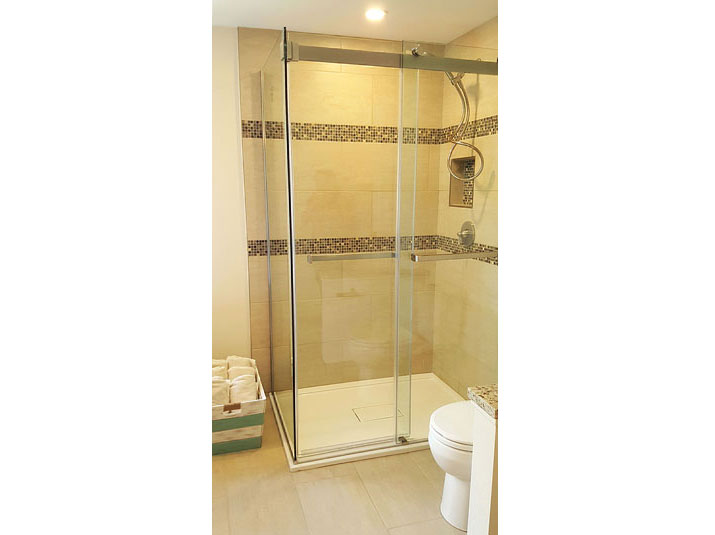 Glass shower with glazed porcelain tiled walls