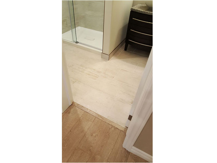Transition strip from laminate to porcelain tile floor