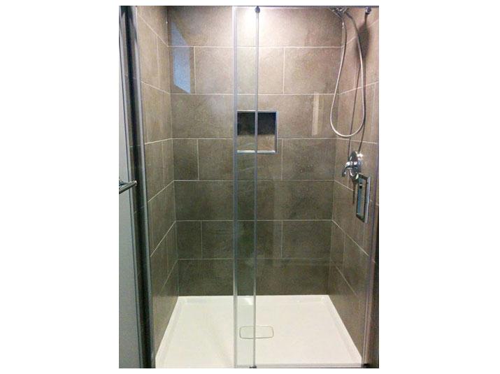 Dark gray subway tiled shower