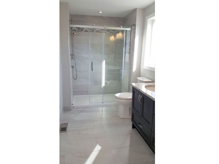 Alcove shower with porcelain subway tiled walls