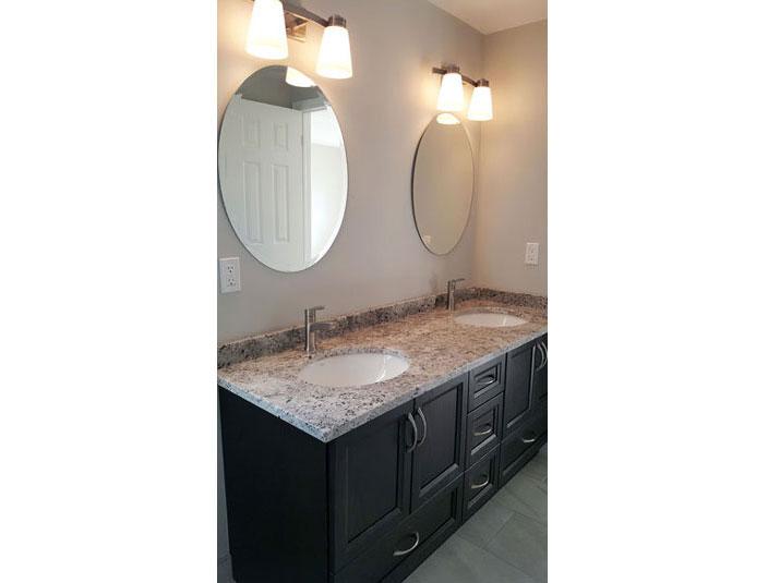Double sink oak vanity with granite countertop