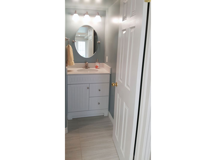 White Bathroom Vanity in basement bathroom
