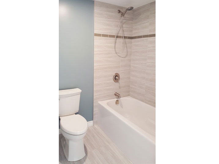 Gray Subway Tiled Shower/Bathtub for basement bathroom