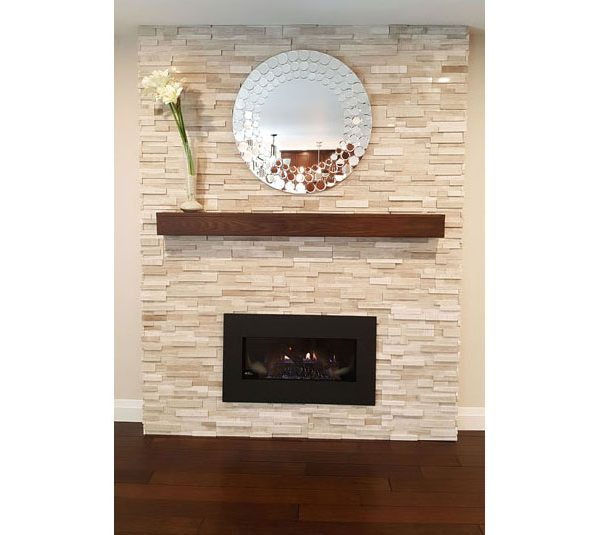 Gas fireplace with stone surround and wood mantel
