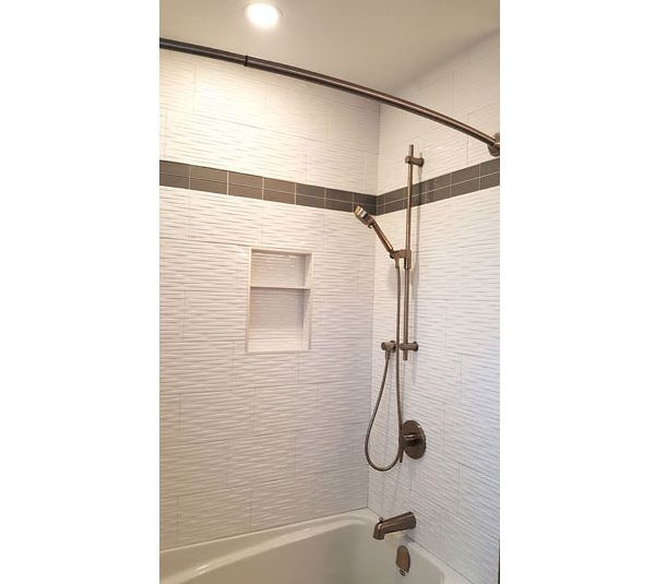 Bathtub/shower with white tile surround