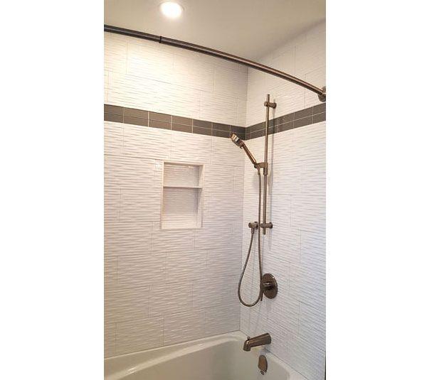 Bathtub/shower with white tile surround