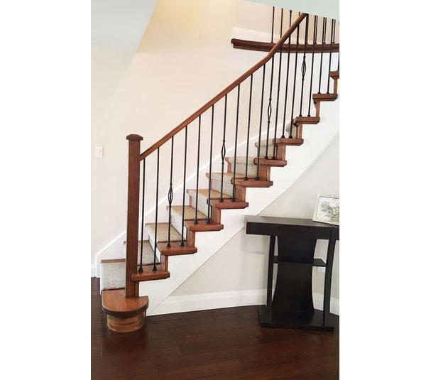 Oak stair system and railing with iron spindles and carpet runner