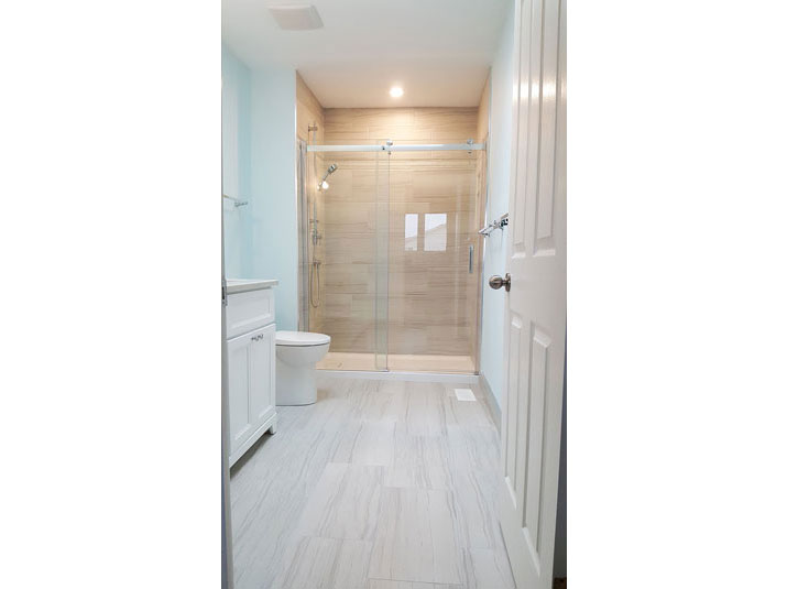 Glazed porcelain tile floor and shower surround