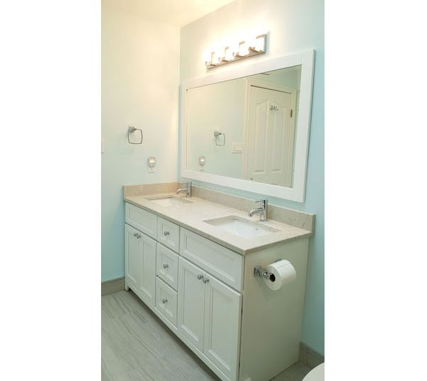 White double sink vanity with matching mirror