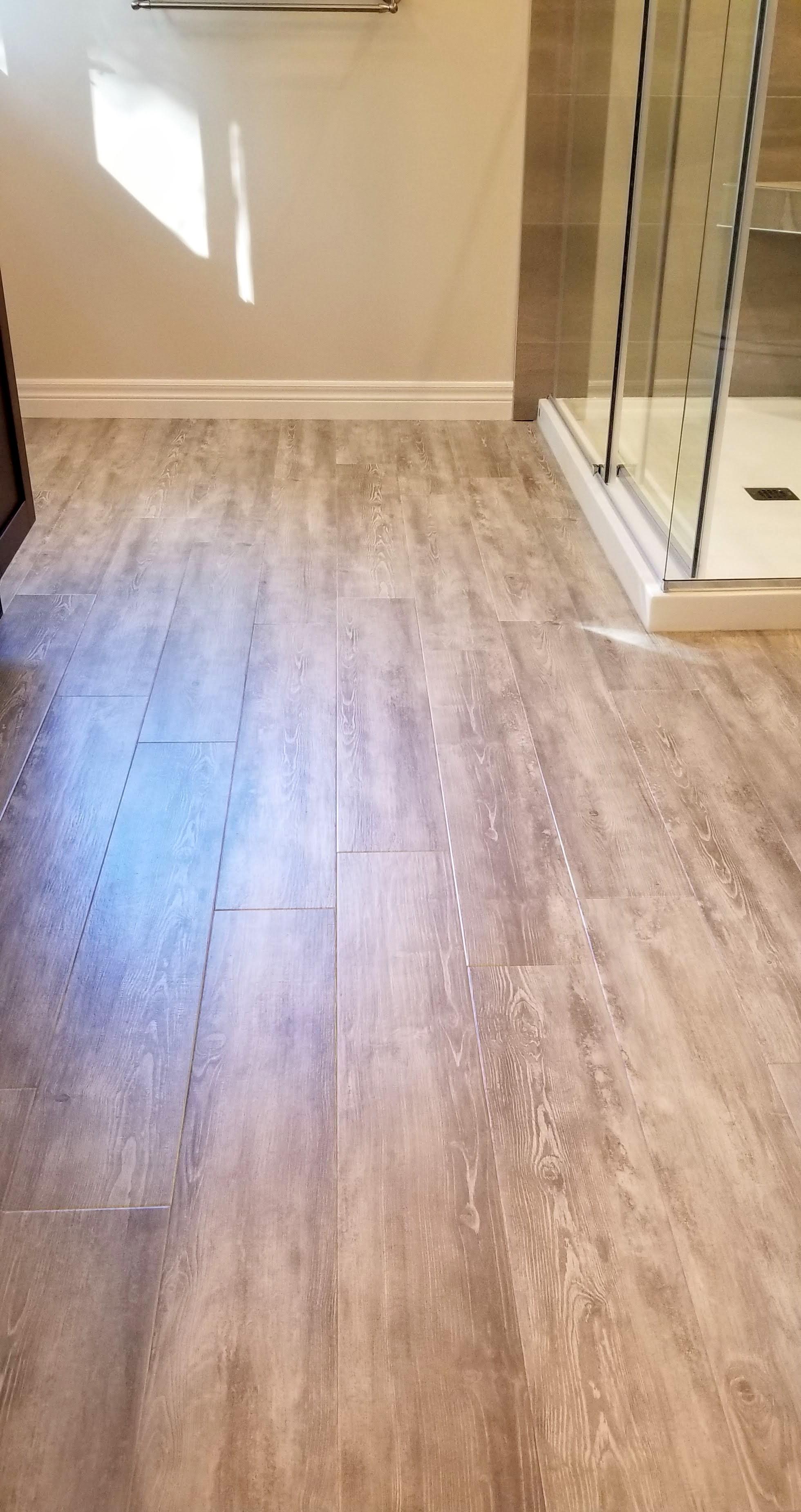 Vinyl plank floor installed in ensuite bathroom floor by Germano Creative Interior Contracting Ltd.