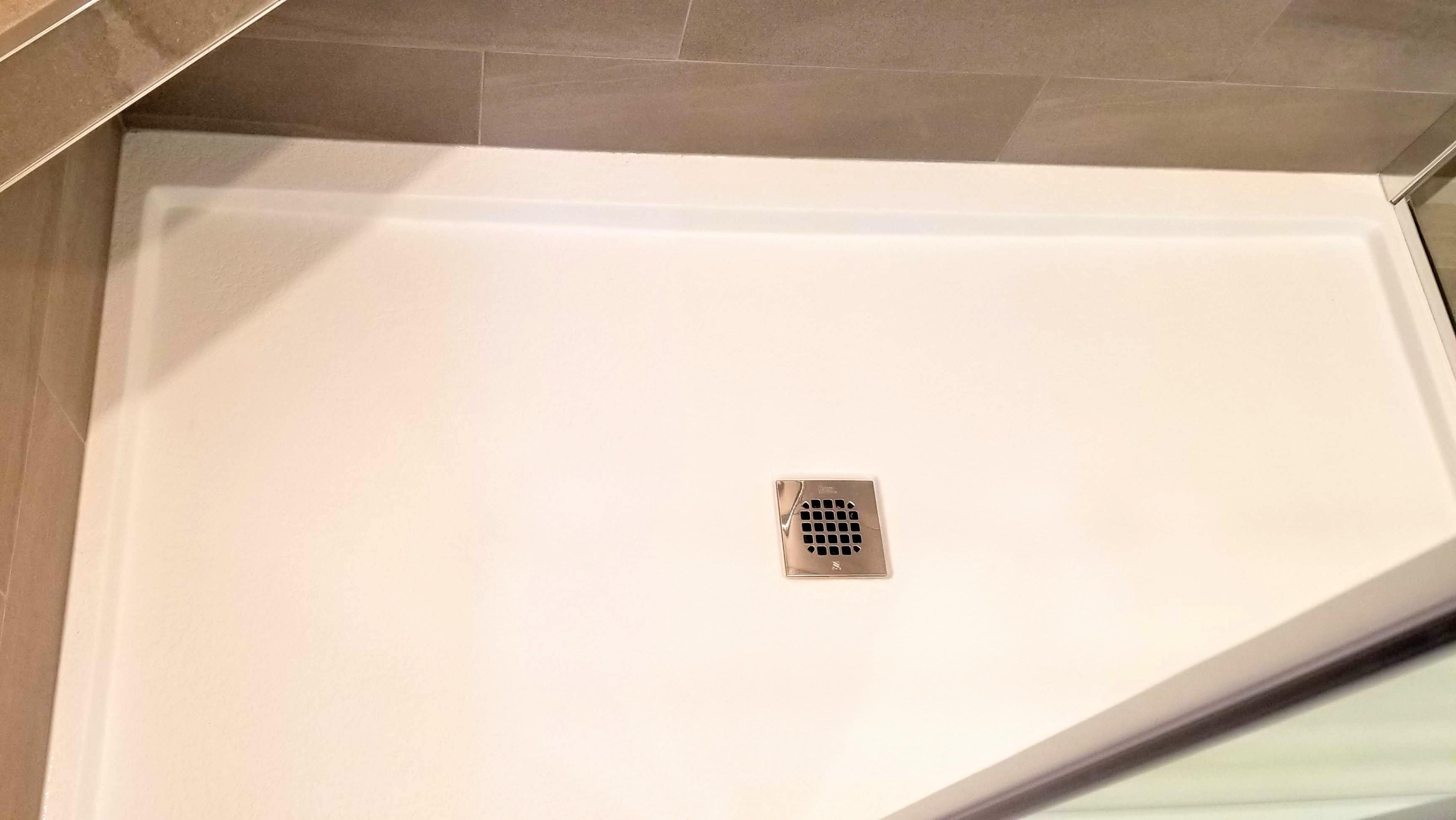 Stone textured shower base