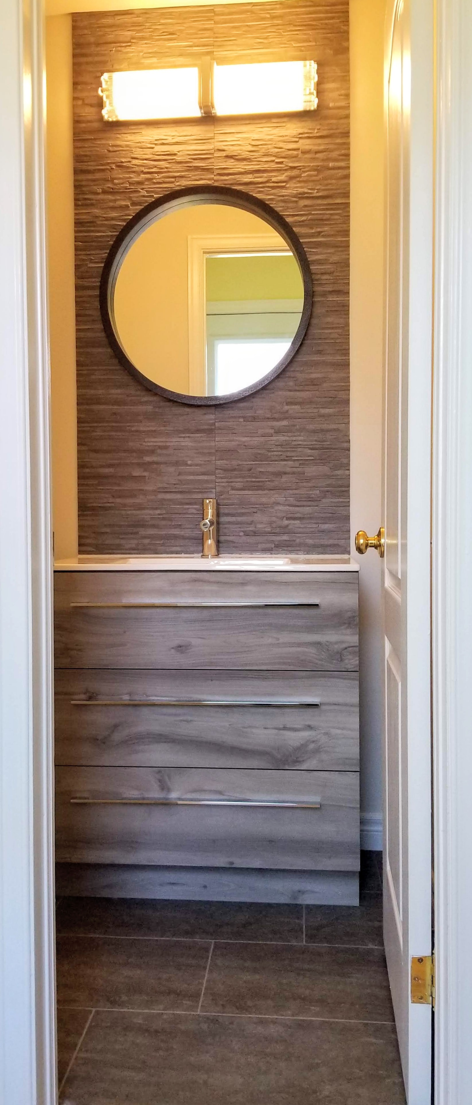Grey bathroom vanity with accent tile wall