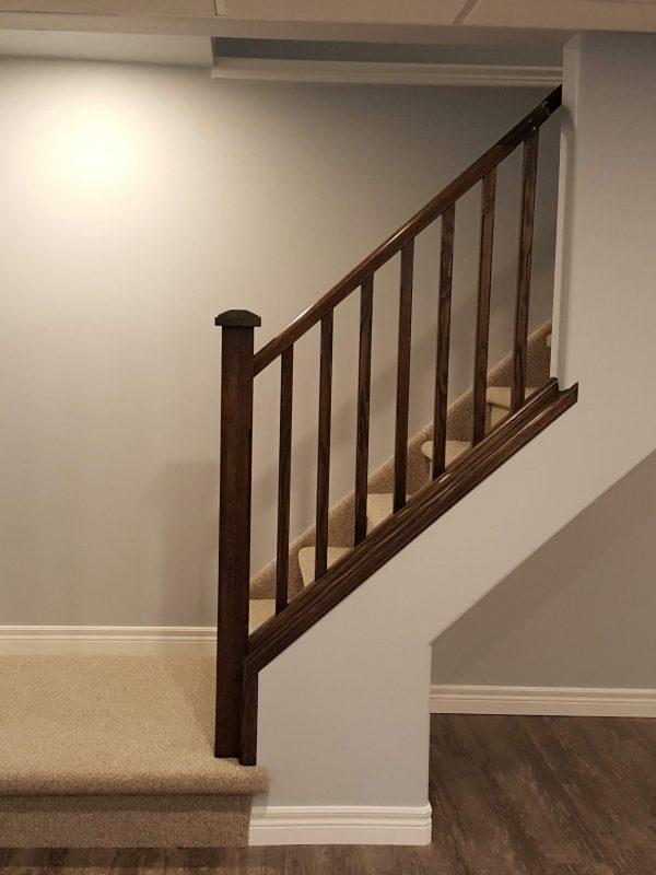 Oak railing in basement