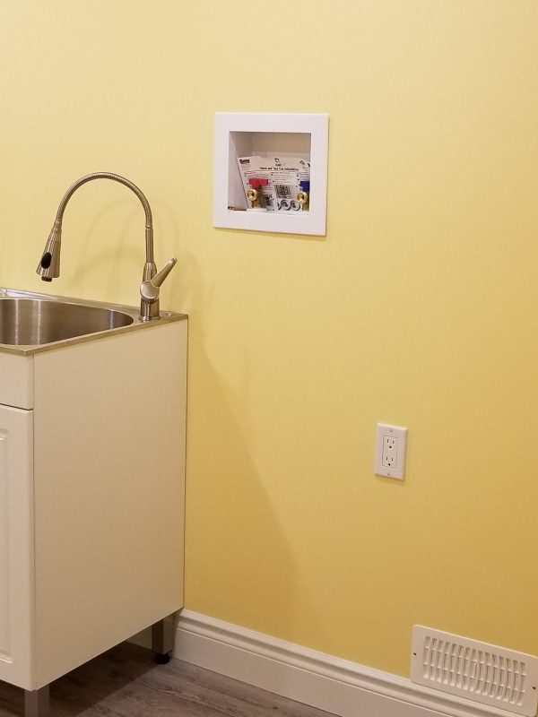 Bright yellow basement laundry room