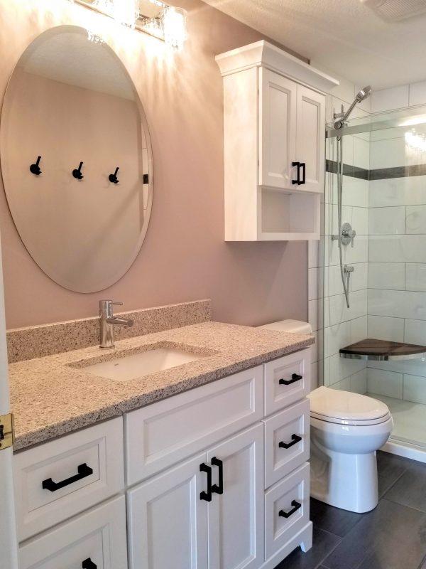 White vanity with quartz countertop