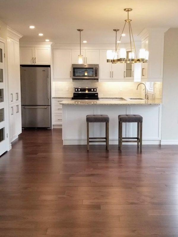 Engineered hardwood throughout main level