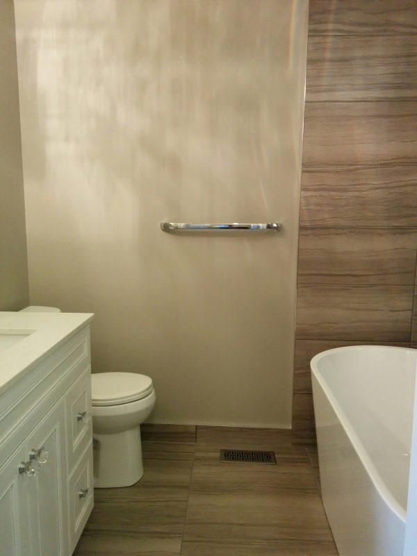 Tiled floors, baseboards and walls