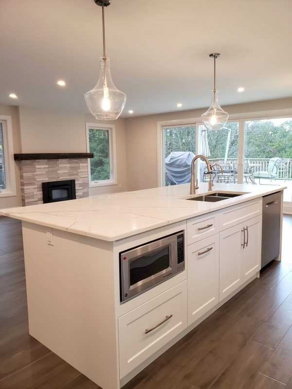 Kitchen island featuring quartz countertops