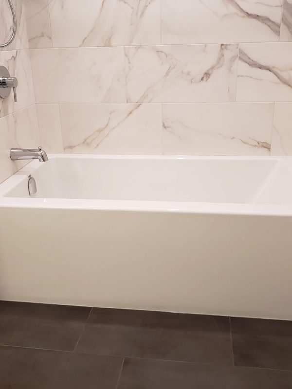 Three wall alcove bathtub