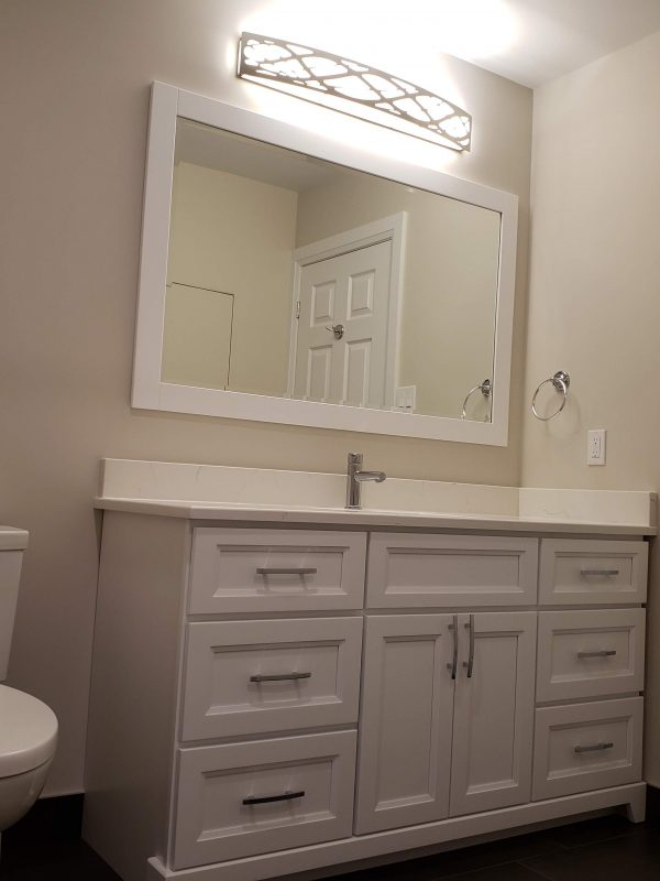 White vanity with matching vanity mirror