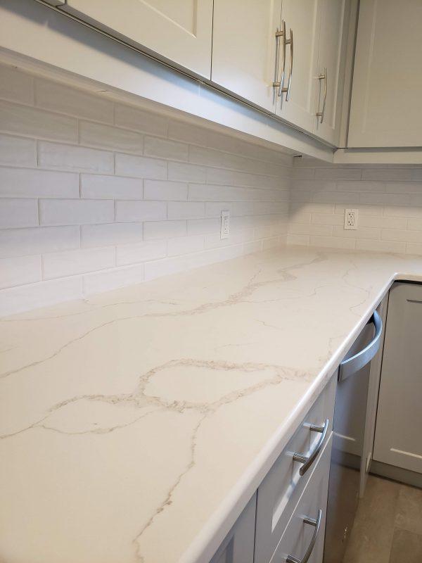 White quartz countertops with white matte backsplash