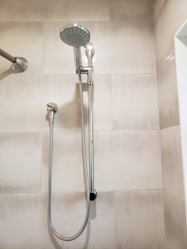 Semi-polished 12x24 porcelain tile shower surround