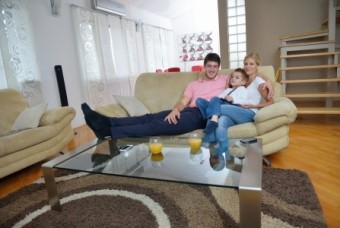 Happy young family in living room