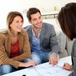 Couple meeting architect for house construction