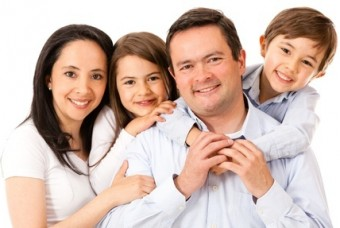 Beautiful happy family isolated over white background