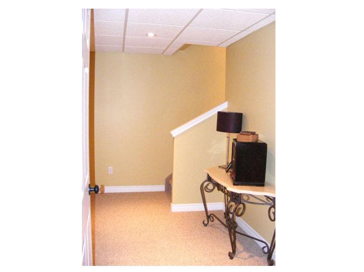 Open concept basement staircase