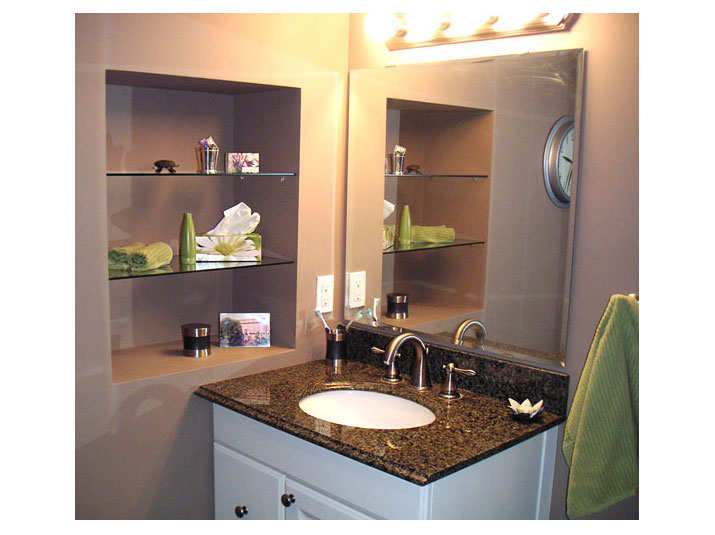 Vanity and recessed niche with glass shelves
