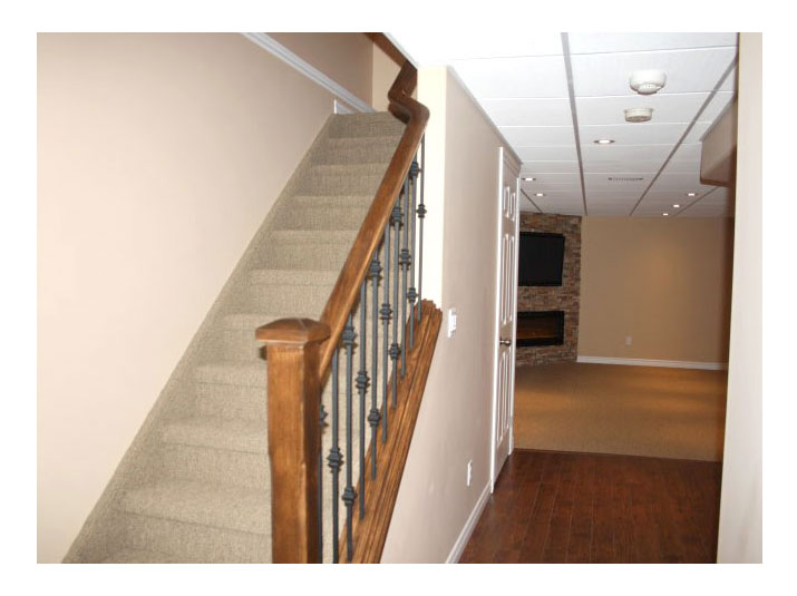 Oak railing with spindles for basement stairs
