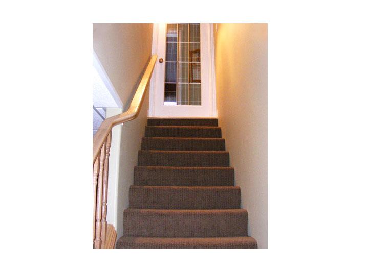 Berber carpet installed for basement stairs