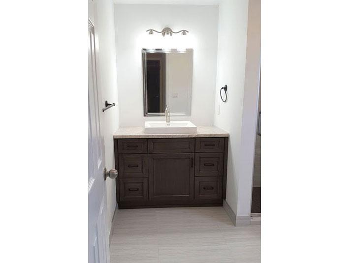 Brown vanity in the Master bathroom