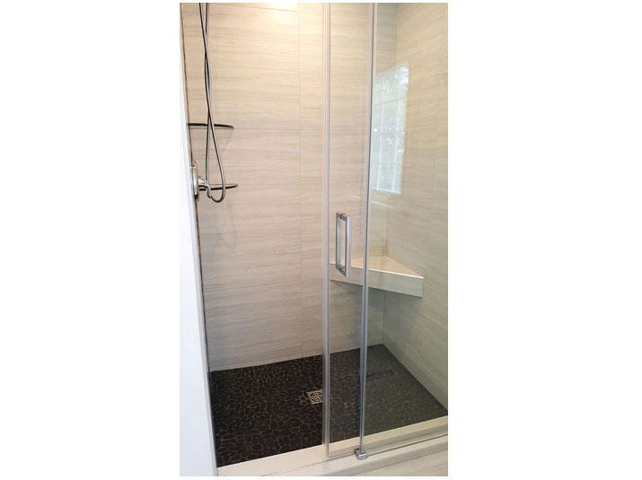 Flat pebble tile shower floor