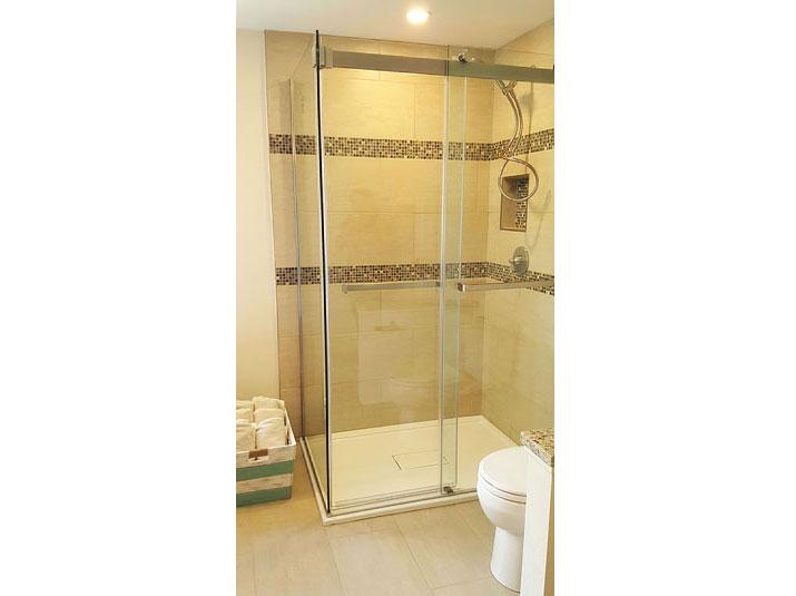 Glass shower with glazed porcelain tiled walls
