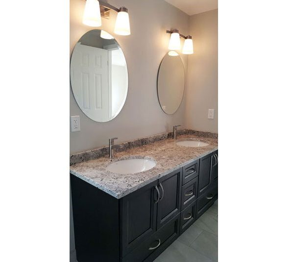 Double sink oak vanity with granite countertop